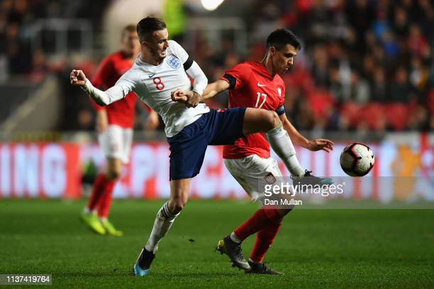James Maddison of England battles for the ball with Bartosz Kapustka of Poland during the U21 International Friendly match between England and Poland...