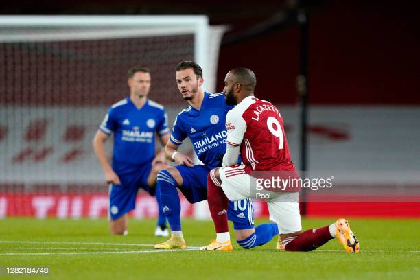 James Maddison of Leicester City and Alexandre Lacazette of Arsenal take a knee in support of the Black Lives Matter movement during the Premier...