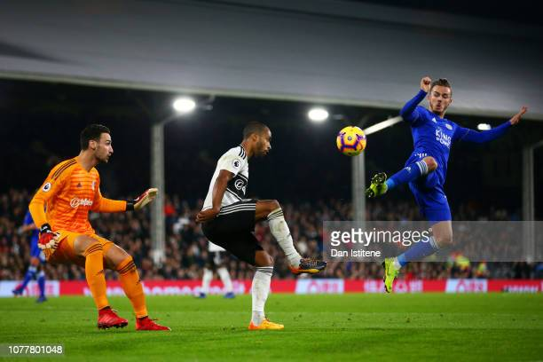 James Maddison of Leicester City attempts to block a clearance from Denis Odoi of Fulham as Sergio Rico looks on during the Premier League match...