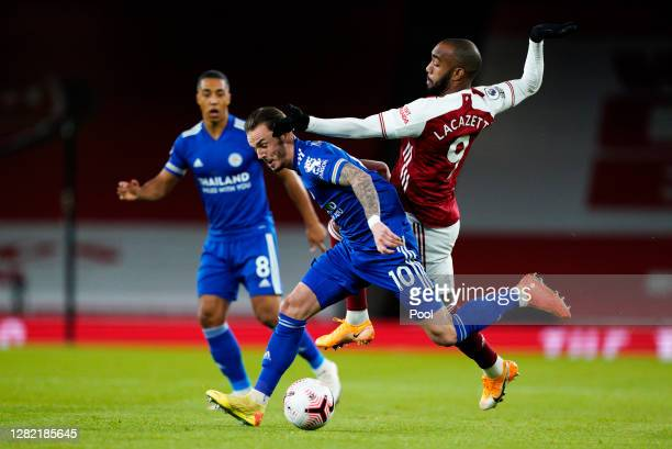 James Maddison of Leicester City battles for possession with Alexandre Lacazette of Arsenal during the Premier League match between Arsenal and...