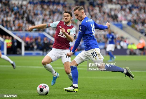 James Maddison of Leicester City battles for possession with Robbie Brady of Burnley during the Premier League match between Leicester City and...