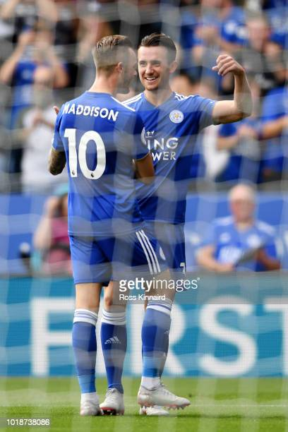 James Maddison of Leicester City celebrates after scoring his team's second goal with teammate Ben Chilwell during the Premier League match between...