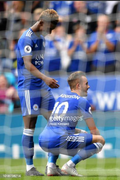 James Maddison of Leicester City celebrates after scoring his team's second goal with teammate Demarai Gray during the Premier League match between...