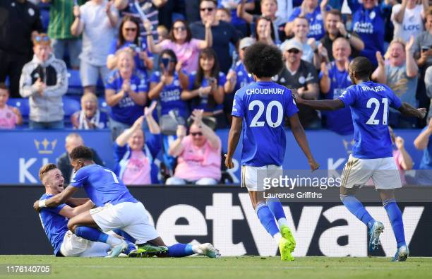 James Maddison of Leicester City celebrates as he scores his team's second goal with Demarai Gray during the Premier League match between Leicester...