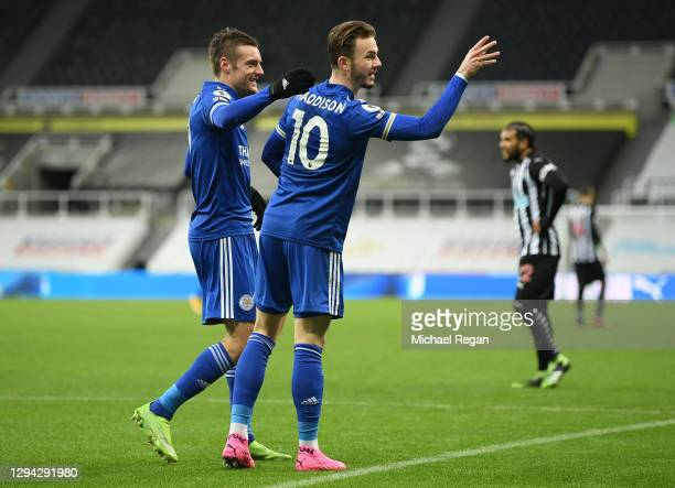 James Maddison of Leicester City celebrates with team mate Jamie Vardy after scoring their sides first goal during the Premier League match between...