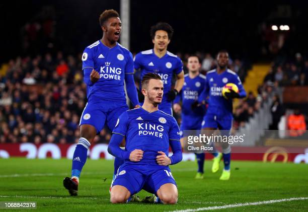 James Maddison of Leicester City celebrates with team mates Demarai Gray and Shinji Okazaki after scoring his team's first goal during the Premier...