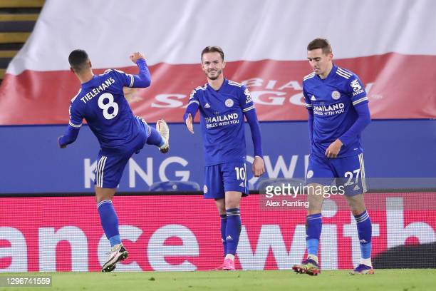 James Maddison of Leicester City celebrates with team mates Youri Tielemans and Timothy Castagne of Leicester City after scoring their side's first...