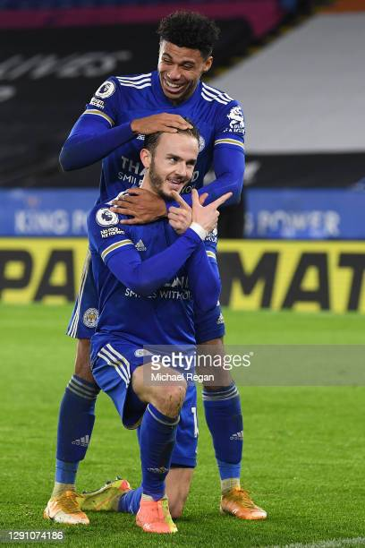 James Maddison of Leicester City celebrates with teammate James Justin after scoring their team's third goal during the Premier League match between...