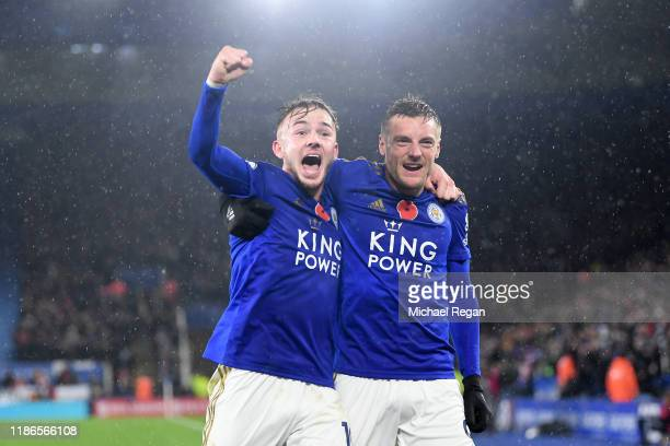 James Maddison of Leicester City celebrates with teammate Jamie Vardy after scoring his team's second goal during the Premier League match between...