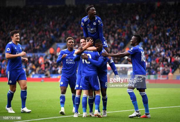 James Maddison of Leicester City celebrates with teammates after scoring his team's second goal during the Premier League match between Leicester...