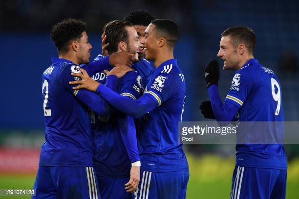 James Maddison of Leicester City celebrates with teammates James Justin, Youri Tielemans and Jamie Vardy after scoring their team's third goal during...