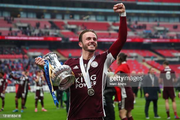 James Maddison of Leicester City celebrates with the Emirates FA Cup trophy following his team's victory in The Emirates FA Cup Final match between...