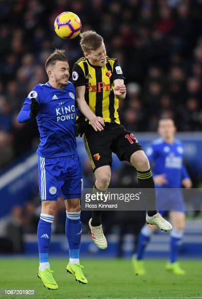 James Maddison of Leicester City competes for a header with Will Hughes of Watford during the Premier League match between Leicester City and Watford...