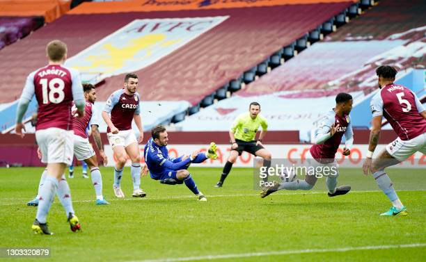 James Maddison of Leicester City has a shot blocked by Ezri Konsa of Aston Villa during the Premier League match between Aston Villa and Leicester...