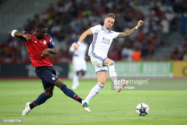 James Maddison of Leicester City in action with Adama Soumaoro of Lille during the preseason friendly match between Lille and Leicester City at Stade...