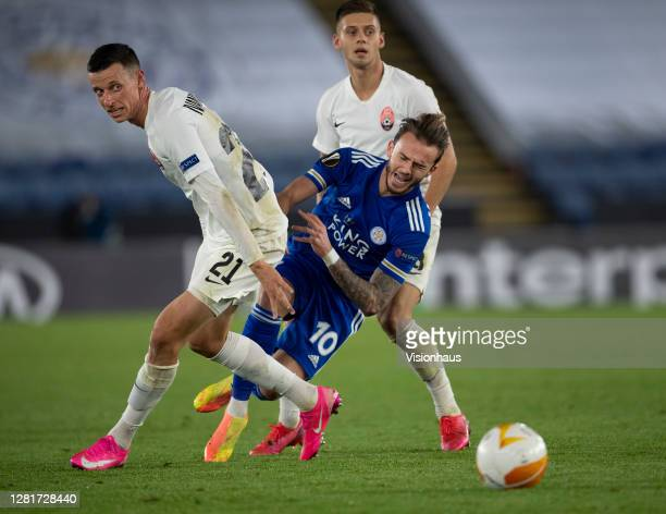 James Maddison of Leicester City in action with Dmytro Ivanisenia and Maksym Lunov of Zorya Luhansk during the UEFA Europa League Group G stage match...
