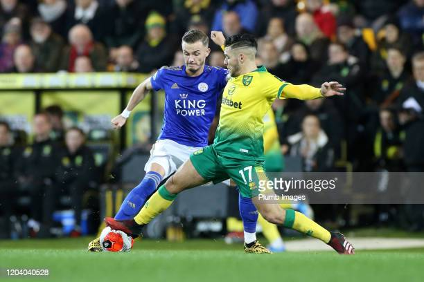 James Maddison of Leicester City in action with Emi Buendia of Norwich City during the Premier League match between Norwich City and Leicester City...