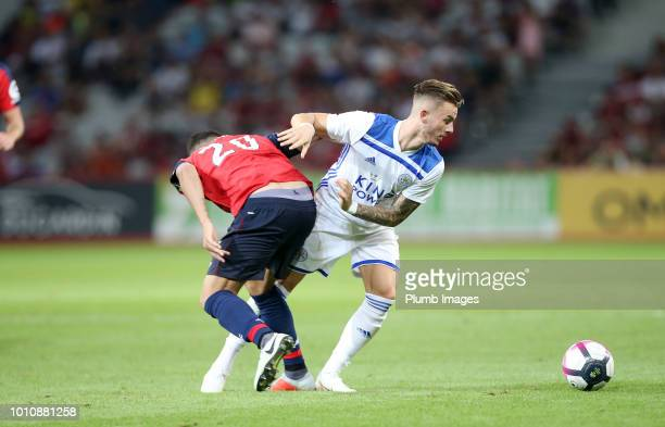 James Maddison of Leicester City in action with Thiago Maia of Lille during the preseason friendly match between Lille and Leicester City at Stade...