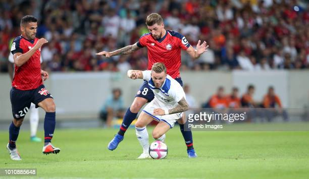 James Maddison of Leicester City in action with Xeka of Lille during the preseason friendly match between Lille and Leicester City at Stade Pierre...