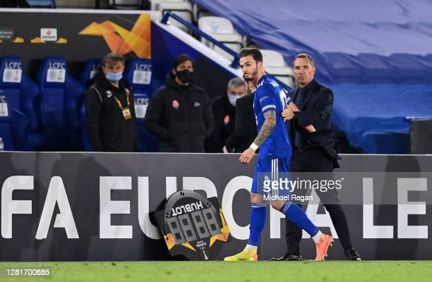 James Maddison of Leicester City interacts with Brendan Rodgers Manager of Leicester City after being substituted during the UEFA Europa League Group...
