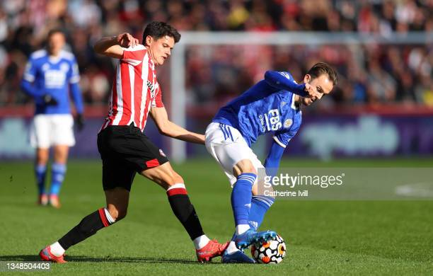 James Maddison of Leicester City is challenged by Christian Norgaard of Brentford during the Premier League match between Brentford and Leicester...