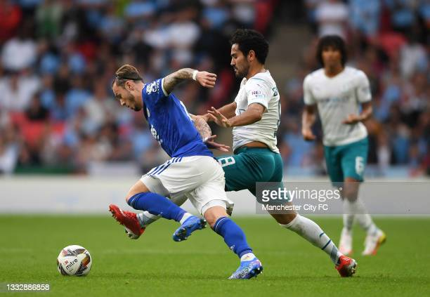 James Maddison of Leicester City is challenged by Ilkay Gundogan of Manchester City during The FA Community Shield Final between Manchester City and...
