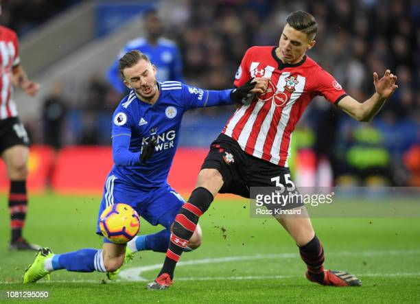 James Maddison of Leicester City is is challenged by Jan Bednarek of Southampton during the Premier League match between Leicester City and...