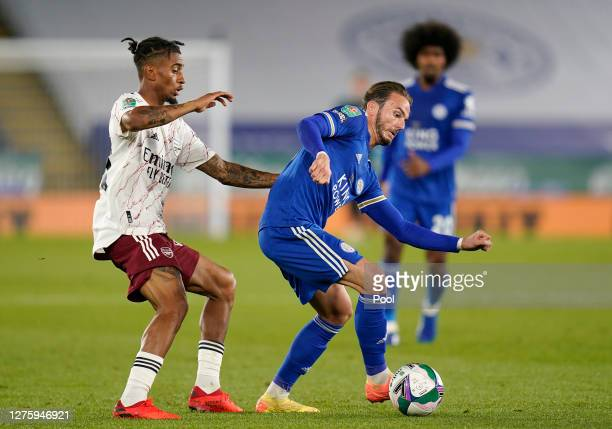 James Maddison of Leicester City is put under pressure by Reiss Nelson of Arsenal during the Carabao Cup third round match between Leicester City and...