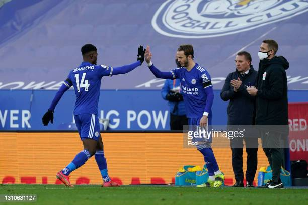 James Maddison of Leicester City is substituted on for teammate Kelechi Iheanacho during the Premier League match between Leicester City and...