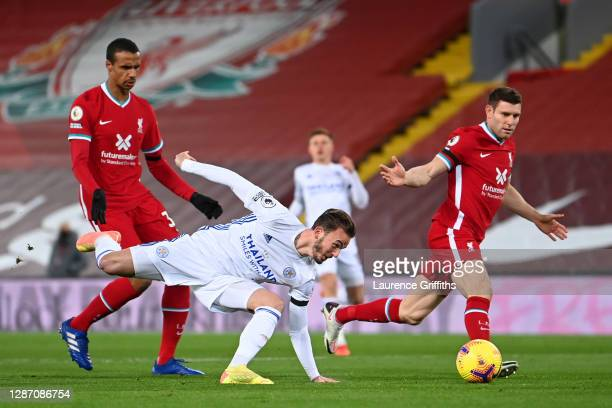 James Maddison of Leicester City misses a chance as he is put under pressure by Joel Matip and James Milner of Liverpool in the area during the...