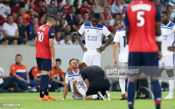 James Maddison of Leicester City receives treatment before going off injured during the preseason friendly match between Lille and Leicester City at...