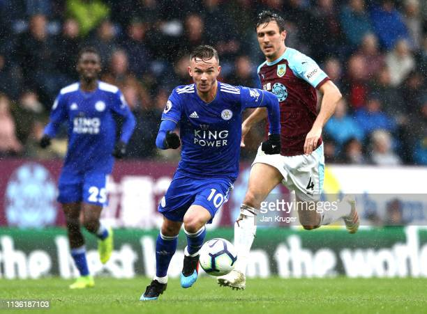 James Maddison of Leicester City runs with the ball during the Premier League match between Burnley FC and Leicester City at Turf Moor on March 16...