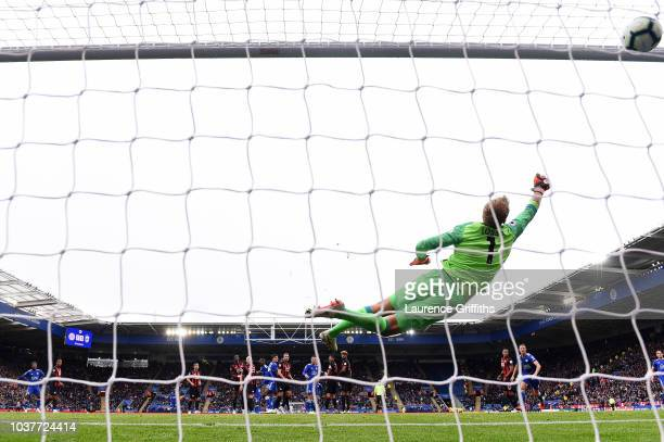 James Maddison of Leicester City scores his team's second goal past Jonas Lossl of Huddersfield Town during the Premier League match between...