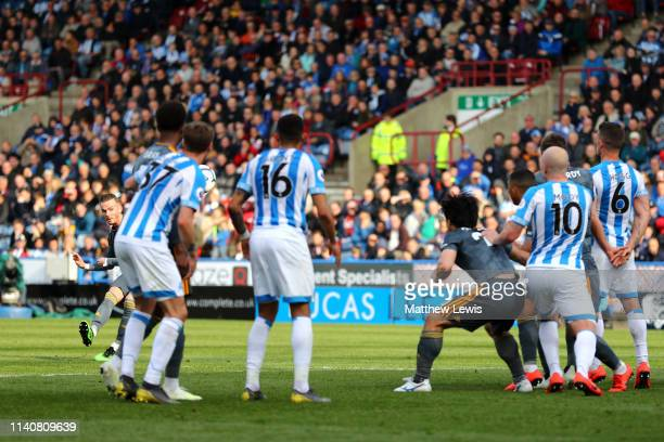 James Maddison of Leicester City scores his team's third goal during the Premier League match between Huddersfield Town and Leicester City at John...