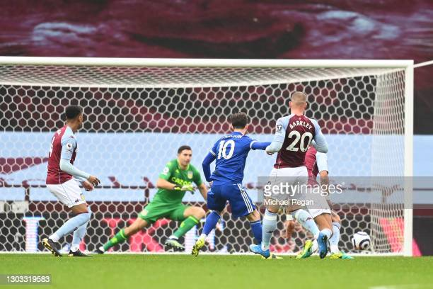 James Maddison of Leicester City scores their side's first goal during the Premier League match between Aston Villa and Leicester City at Villa Park...