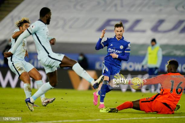 James Maddison of Leicester City scores their sides second goal past Edouard Mendy of Chelsea during the Premier League match between Leicester City...