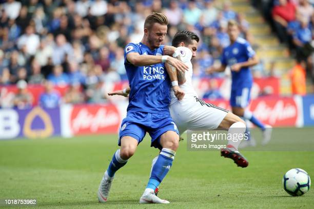 James Maddison of Leicester City struggles for the ball against Joao Moutinho of Wolverhampton Wanderers during the Premier League match between...