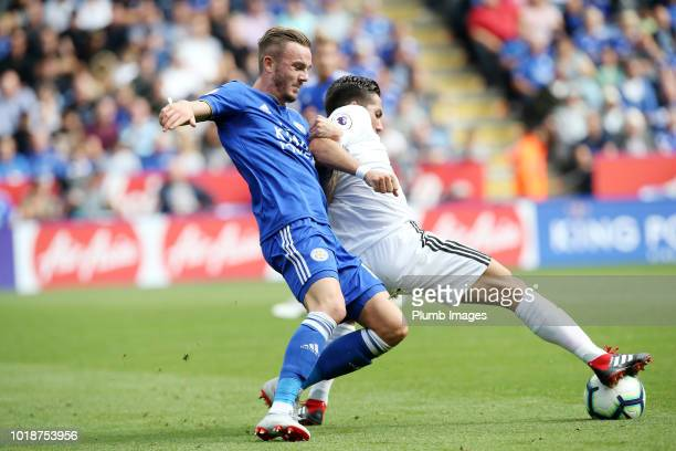 James Maddison of Leicester City struggles for the ball with Joao Moutinho of Wolverhampton Wanderers during the Premier League match between...