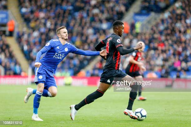 James Maddison of Leicester City tries to pull back Adama Diakhaby of Huddersfield Town during the Premier League match between Leicester City and...
