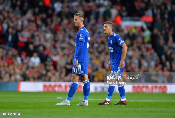James Maddison of Leicester City with Adrien Silva during the Premier League match between Manchester United and Leicester City at Old Trafford on...