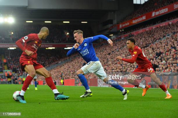 James Maddison of Leicester City with Fabinho and Trent AlexanderArnold of Liverpool during the Premier League match between Liverpool FC and...