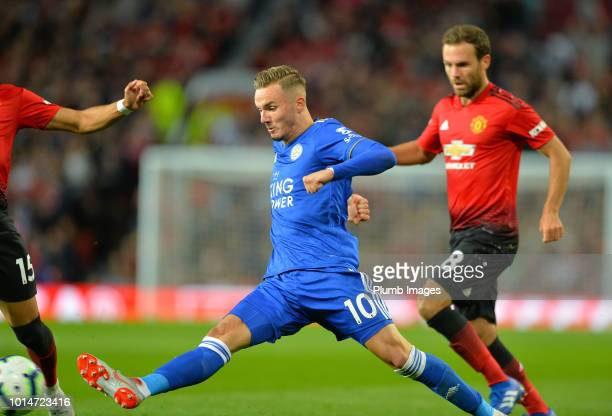 James Maddison of Leicester City with Juan Mata of Manchester United during the Premier League match between Manchester United and Leicester City at...
