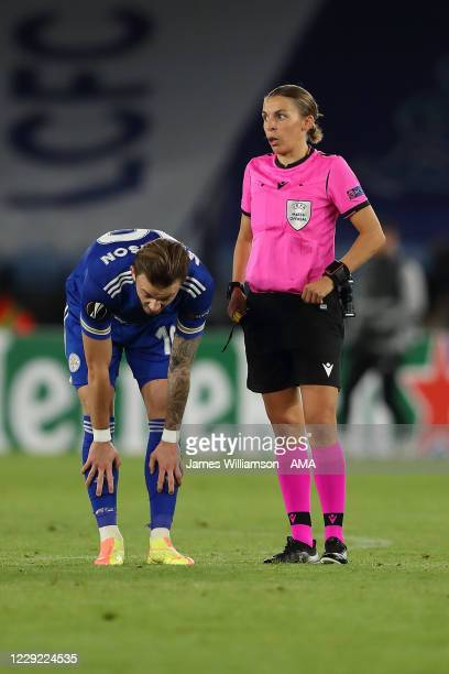 James Maddison of Leicester City with Match referee Stephanie Frappart of France during the UEFA Europa League Group G stage match between Leicester...