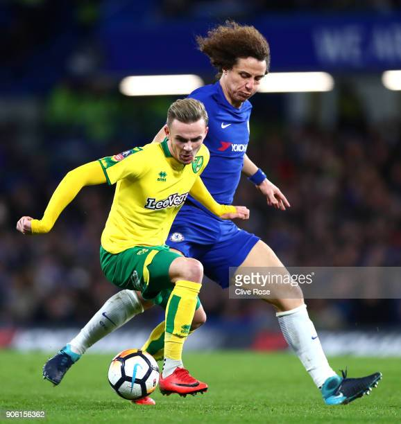 James Maddison of Norwich City and David Luiz of Chelsea in action during The Emirates FA Cup Third Round Replay between Chelsea and Norwich City at...