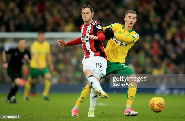 James Maddison of Norwich City and Richard Stearman of Sheffield United compete for the ball during the Sky Bet Championship match between Norwich...