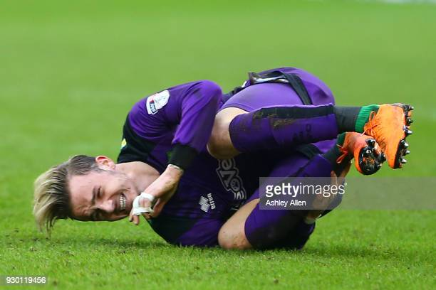 James Maddison of Norwich City grimaces in pain during the Sky Bet Championship match between Hull City and Norwich City at KCOM Stadium on March 10...