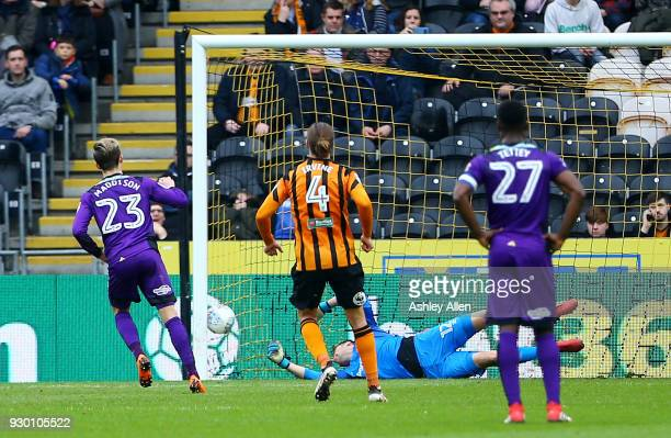 James Maddison of Norwich City scores a penalty past goalkeeper David Marshall of Hull City during the Sky Bet Championship match between Hull City...