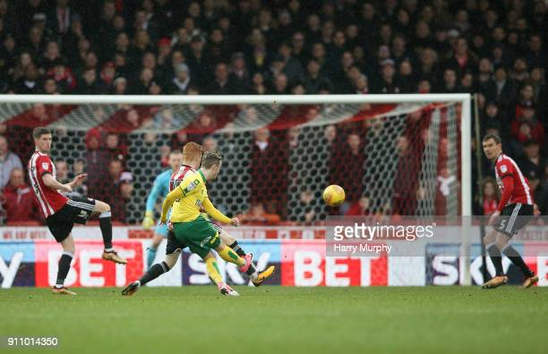 James Maddison of Norwich City scores his sides first goal during the Sky Bet Championship match between Brentford and Norwich City at Griffin Park...