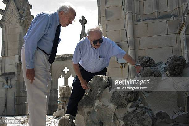 James Madison Cutts consulting engineer left and architect Tony Segreti inspect a fallen pinnacle on the roof of the Gloria in Excelsis tower at The...