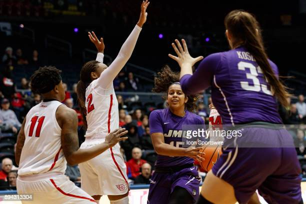 James Madison Dukes guard Lexie Barrier looks to pass the ball to James Madison Dukes forward Kelly Koshuta during a game between the James Madison...